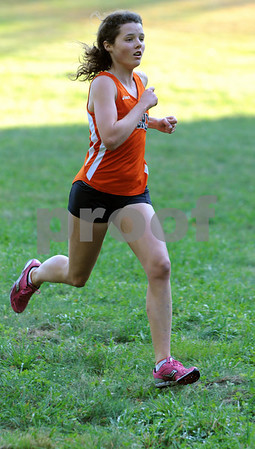 Beverly:<br /> Millie Chapman is the first place winner in the girls race at the Beverly High cross country meet vs. Revere at the J.C. Phillips Nature Preserve course.<br /> Photo by Ken Yuszkus/Salem News, Tuesday October 13, 2009.