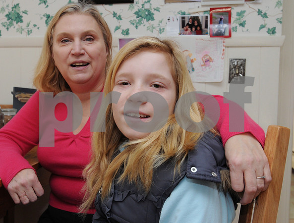 Beverly:<br /> From left is Santa Vjakse, 12, with Ann Crowley. Santa is an orphan from Latvia and is in this country for a few weeks visiting Ann and her family. She received an operation in a Boston hospital for free.<br /> Photo by Ken Yuszkus/Salem News, Friday,  January 9, 2009.