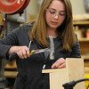 Middleton:<br /> Victoria Ambrifi, of Danvers, a freshman, works on a project in carpentry at North Shore Technical High School.<br /> Photo by Ken Yuszkus/Salem News, Thursday,  March 22, 2012.