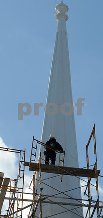 Beverly:<br /> Workmen disassemble and remove the scaffolding surrounding the steeple of The First Baptist Church in Beverly. The scaffolding was needed while the steeple was painted.<br /> Photo by Ken Yuszkus/Salem News, Monday,  February 9, 2009.