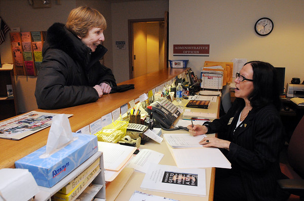 Beverly:<br /> Frances Powers, left, arranges an appointment to have her taxes prepared. Marjorie O'Brien, receptionist secretary, takes down the information at the Beverly Council on Aging on Wednesday afternoon.<br /> Photo by Ken Yuszkus/Salem News, Wednesday, January 26, 2011.