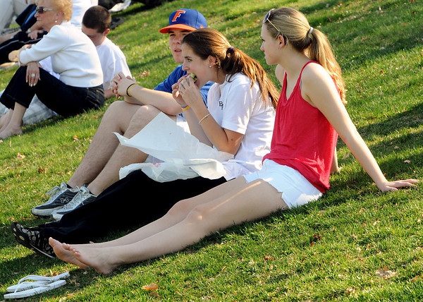 Peabody:<br /> From left, Tom Gaudet, Maura Doyle, and Rachel Stueve, all of Peabody, watch the St. Mary's Lynn at Bishop Fenwick softball game. <br /> Photo by Ken Yuszkus/Salem News, Wednesday, April 7, 2010.