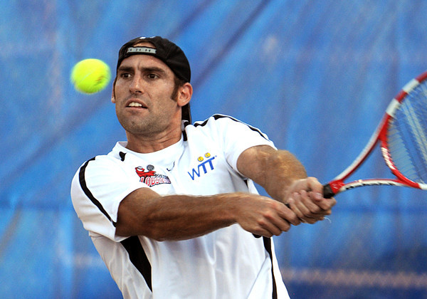 Middleton:<br /> Boston Lobsters' Robby Ginepri keeps his eyes on the ball during the Boston Lobsters pro tennis team home (and season) opening match against the Sacramento Capitals at the Joan Norton Stadium.<br /> Photo by Ken Yuszkus/Salem News, Monday, July 9,  2012.