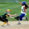 Danvers:<br /> Danvers' Janelle Saggese, right, is about to slide safe, stealing second as North Reading's Meredith Moise waits for the ball during the North Reading at Danvers Division 2 North first round state tournament game.<br /> Photo by Ken Yuszkus/Salem News, Thursday, June 2, 2011.