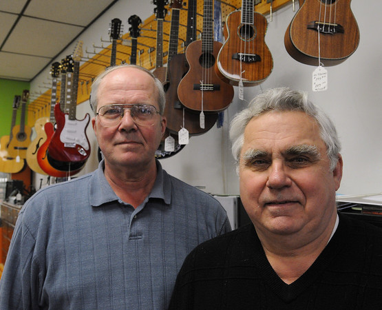 Salem:<br /> Paul Audet, left, and Jerry Cole, are co-owners of Ted Cole's Music Shop which will be closing next month. <br /> Photo by Ken Yuszkus/Salem News, Wednesday, April 20, 2011.