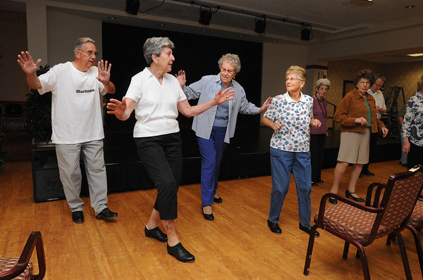 Peabody:<br /> From left, Jim Kusch, Joan Havey, Sonia Sternberger, and Florence Perkins, practice dance steps along with the other residents in preparation for the upcoming 10-year anniversary festivities this week.<br /> Photo by Ken Yuszkus/Salem News, Tuesday, June 1, 2010.
