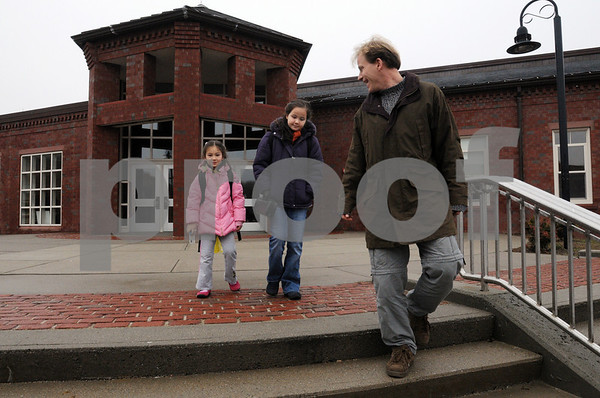 Ipswich:<br /> Sam Folta escorts his two daughters, Anna who is in the 4th gtrade and Joanna who is in the 1st grade, both at the Winthrop School, out of the Ipswich Middle School where they were taken after a strong odor of gas was detected at the Winthrop School. Parents could pickup their children from the Ipswich Middle School and bring them home, otherwise the students stayed at the Ipswich Middle School.<br /> Photo by Ken Yuszkus/Salem News, Monday December 1, 2008.