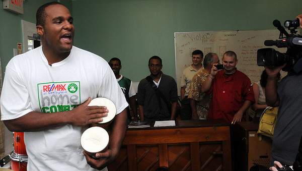 """Salem:<br /> Celtics Glen """"Big Baby"""" Davis, plays the bongos and sings while visiting the music room at the Plummer Home for Boys during a tour. Celtics Glen """"Big Baby"""" Davis and former Celtics, Cedric Maxwell, were there for the dedication of the basketball court that the Celtics helped build along with the NFL quarterback Steve Young's Foundation. They also shot a few hoops with the kids.<br /> Photo by Ken Yuszkus/Salem News, Monday August 16, 2010."""