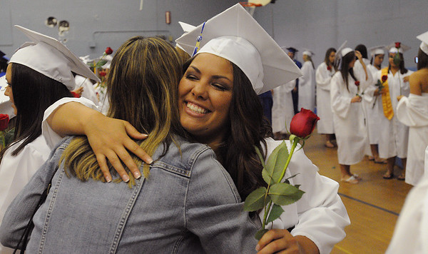 Danvers:<br /> Graduate Chelsey Drillis gets a hug from teacher Lori Anketell before the Danvers High School graduation at Dr. Deering Stadium. <br /> Photo by Ken Yuszkus/Salem News, Monday, June 13, 2011.