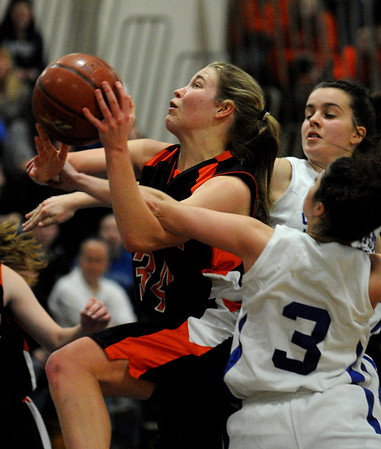 Wilmington:<br /> Ipswich's Hannah O'Flynn goes up for a shot and is tangled in the arm of a Stoneham player at the Ipswich vs Stoneham girls basketball game in the Division 3 North semifinals at Wilmington High School.<br /> Photo by Ken Yuszkus/Salem News, Thursday March 10, 2011.
