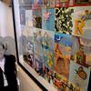 Salem:<br /> Giles Laroche created the art on the wall depicting the life of Sister Fernande Richard. Sister Fernande Richard is looking at the framed art hanging at St. Joseph School.<br /> Photo by Ken Yuszkus/Salem News, Wednesday, November 12, 2008.