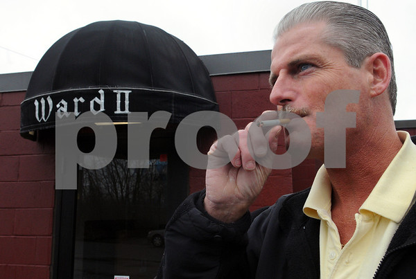 Salem:<br /> Patrick Hagen, manager of Ward 2 Social Club, smokes outside the club. Ward 2 Social Club recently voted to ban smoking. The club and many others fought the city ban and were the last refuge for smokers. Now they are voluntarily banning smoking.<br /> Photo by Ken Yuszkus/Salem News, Wednesday, March 11, 2009.