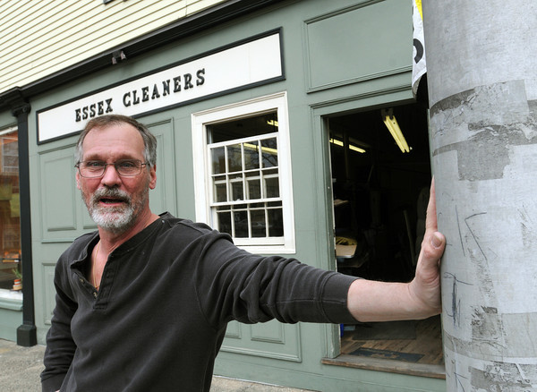Salem:<br /> Michael Szczuka, owner of Essex Cleaners, is in front of his business where the current free parking exists. The city plans to install parking meters in front of Essex Cleaners, which has always had 15 minute stop-and-go parking spaces in front of it.<br /> Photo by Ken Yuszkus/Salem News, Thursday, April 26, 2012.