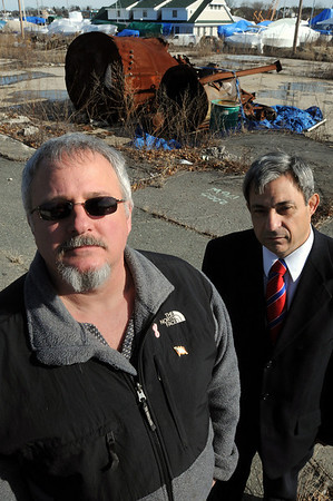 Danvers:<br /> Jim Turcotte, left, and state representative (D) Ted Speliotis, Danvers, stand near the site of the CAI's former plant.  Jim Turcotte is pushing a bill to require steam boiler operators who operate low pressure boilers be licensed. The Danversport resident is president of the Chapter 146 Association that oversees such issues, and he is a victim of the Nov. 22, 2006 blast.<br /> Photo by Ken Yuszkus/Salem News, Friday, March 5, 2010.