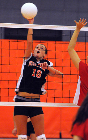 Beverly:<br /> Beverly's Andrea French moves the ball over the net during the Saugus at Beverly girls volleyball game.<br /> Photo by Ken Yuszkus/Salem News, Monday, October 17, 2011.