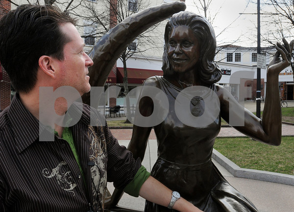 Salem:<br /> Mark Wood, plans to open a Bewitched museum and B&B in downtown Salem. He is looking toward the Bewitched statue at the corner of Washington Street and Essex Street..<br /> Photo by Ken Yuszkus/Salem News, Friday, April 10, 2009.