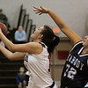 Marblehead:<br /> Marblehead's Ariana Freddo, left, goes up for a basket as Brittany LeFave of Peabody reaches over at the Peabody High School vs Marblehead High School girls varsity basketball game at Marblehead.<br /> Photo by Ken Yuszkus/Salem News, Tuesday, January 11, 2011.