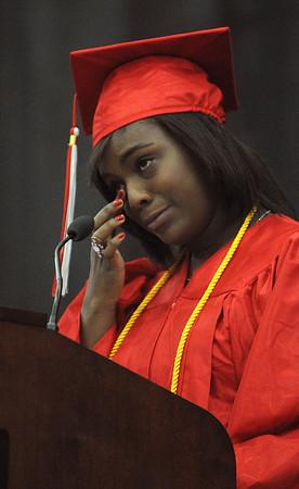 Salem:<br /> Class president Gaelle Mondestin wipes a tear from her eye as she gives her emotional speech at Salem High  graduation.<br /> Photo by Ken Yuszkus/Salem News, Friday, June1, 2012.