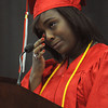 Salem:<br /> Class president Gaelle Mondestin wipes a tear from her eye as she gives her emotional speech at Salem High  graduation.<br /> Photo by Ken Yuszkus/Salem News, Friday, June1, 2012.