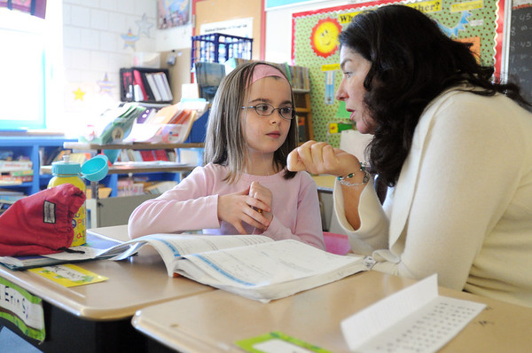 Salem:<br /> Principal Renata McFarland speaks with 3rd grader Erin Sargent during geometry at the Bentley Elementary School during her morning rounds at the school.<br /> Photo by Ken Yuszkus/Salem News, Wednesday, January 18, 2012.