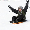 Beverly:<br /> Spencer Brown, 11, raises his arms while sledding downhill at Lynch Park in Beverly. <br /> Photo by Ken Yuszkus/Salem News, Friday, January 14, 2011.