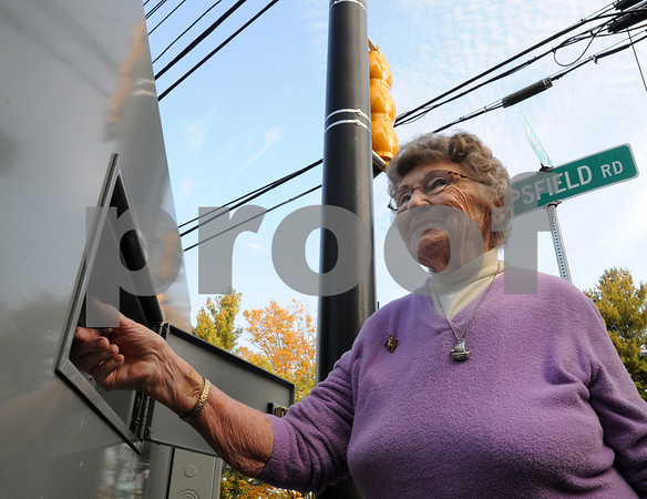 Wenham:<br /> Bessie Marilyn Oro flicks the switch to make the new traffic lights function on the corner of Maple Street and Topsfield Road.<br /> Photo by Ken Yuszkus/Salem News, Tuesday October 14, 2008.