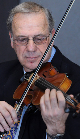 Beverly:<br /> Alan Hawryluk with his violin.<br /> Photo by Ken Yuszkus/Salem News, Friday, January 29, 2010.