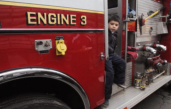 Wenham:<br /> Brayden Haley, of Beverly, explores engine 3 at the Wenham Fire department open house on Wednesday evening.<br /> Photo by Ken Yuszkus/Salem News, Wednesday, October 12, 2011.