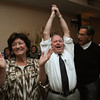 Beverly:<br /> Mayor Bill Scanlon, center, with his wife Louise, left, and Larry Herman, right, react to winning the Beverly mayorial race.<br /> Photo by Ken Yuszkus/Salem News, Tuesday, November 8, 2011.
