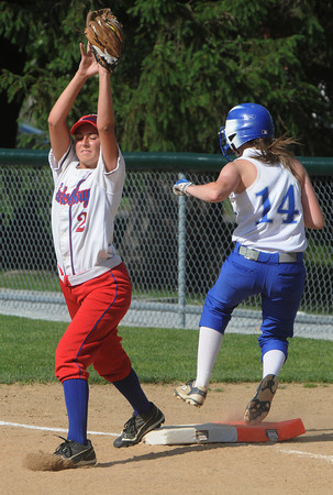 Danvers:<br /> Danvers' Kendall Meehan gets onto first safely during the Tewksbury at Danvers High softball state tournament game.<br /> Photo by Ken Yuszkus/Salem News, Thursday, May 31, 2012.