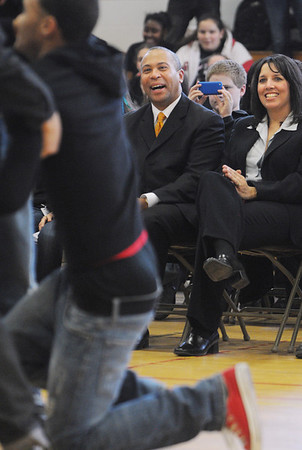 Salem:<br /> Gov. Patrick and Salem Mayor Driscoll watch the Fly Kids perform at the Collins Middle School gym which was part of the anti-bullying program at the school on Wednesday afternoon.<br /> Photo by Ken Yuszkus/Salem News, Wednesday, January 25, 2012.