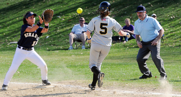 Peabody:<br /> Bishop Fenwick's pitcher, Allissa Begin, runs to first base after a bunt as St. Mary's Kristina Burri tags the base to get her out at the St. Mary's Lynn at Bishop Fenwick softball game. <br /> Photo by Ken Yuszkus/Salem News, Wednesday, April 7, 2010.
