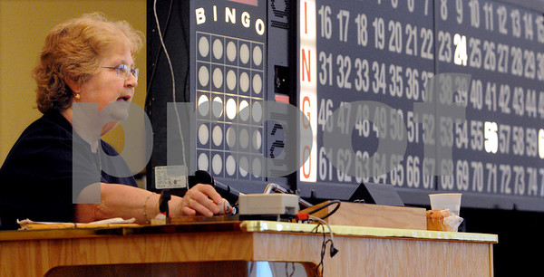 Beverly:<br /> Cecile Robinson calls out the numbers on the stage at the bingo games at the Council On Aging Senior Community Center. The Friends of the Council of Aging lost money on bingo in 2008 for the first time since they started holding the games in 1993.<br /> Photo by Ken Yuszkus/Salem News, Friday March 6, 2009.