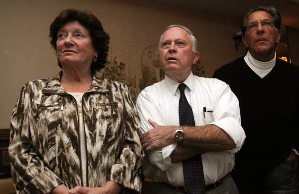 Beverly:<br /> Mayor Bill Scanlon, center, with his wife Louise, left, and Larry Herman, right, watch the tallying of the results of the Beverly mayorial race.<br /> Photo by Ken Yuszkus/Salem News, Tuesday, November 8, 2011.