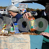 Danvers:<br /> Gayle Sullivan, left, and Sue Gabriel, director of Boot Straps, sort the incoming jars, cans, and other food, while checking expiration dates. Sen. Fred Berry organized a day-long family festival to get donations for 6 local food pantries in Salem, Beverly, Peabody and Danvers.<br /> Photo by Ken Yuszkus/Salem News, Sunday October 25, 2009.