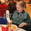 Salem:<br /> Sarah Whitcomb, freshman at Salem High School, serves a turkey dinner to Shirley Knight at the Salem High School auditorium. The high school hosted the annual Senior Citizen Thanksgiving Lunch on Wednesday.<br /> Photo by Ken Yuszkus/Salem News, Wednesday November 20, 2008.