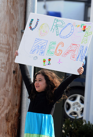 Danvers:<br /> Angela DeAngelis holds up her sign as Meghan Duggan, 2010 U.S. women's hockey silver medalist from Danvers, rides by on an antique firetruck during the parade in her honor.<br /> Photo by Ken Yuszkus/Salem News, Sunday, March 21, 2010.