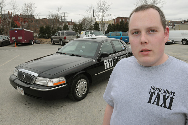 Peabody:<br /> North Shore Taxi general manager Sean McKinnon stands near one of his taxies.<br /> Photo by Ken Yuszkus/Salem News, Thursday,  March 15, 2012.