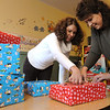 Danvers:<br /> Jen Machado, left, and Carla King, volunteers, wrap presents for a large holiday party for foster kids on Saturday evening.<br /> Photo by Ken Yuszkus/Salem News, Thursday, December 8, 2011.