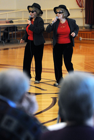 Beverly:<br /> Lyn and Jan DeBenedictus, of American Guild of Variety Artists, sing while performing at the Senior holiday party at the Beverly Senior Center on Thursday.<br /> Photo by Ken Yuszkus/Salem,  News, Thursday,  December 16, 2010.
