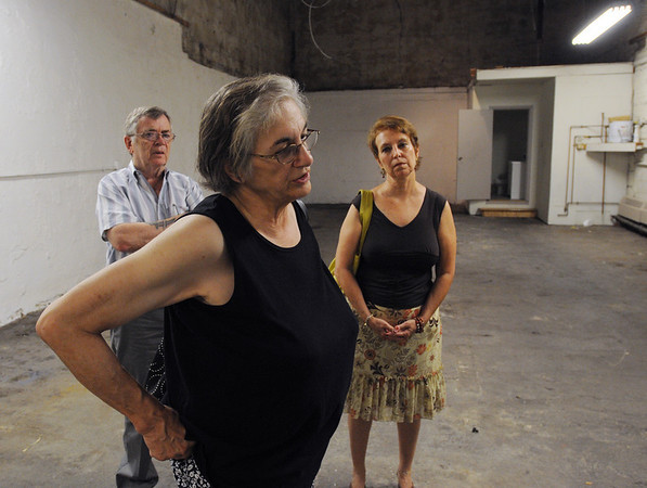 Salem:<br /> Veann Campbell, center, volunteer director, is leading a tour inside the new St. Joseph's Food Pantry at 13 Franklin Street. In the background are John Boris, left, and Noreen Cavanaugh, right, consultant for non profits. <br /> Photo by Ken Yuszkus/Salem News,Monday, July 12, 2010.