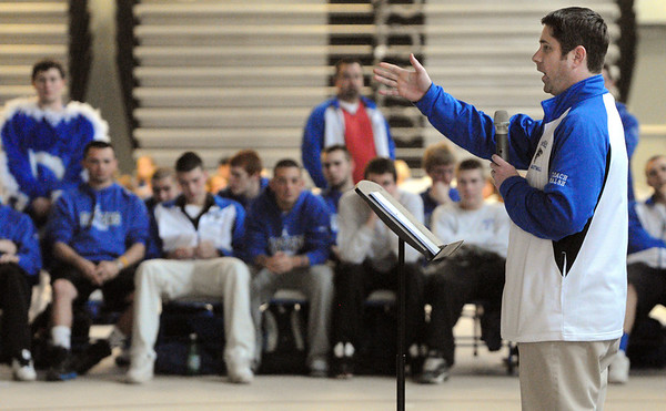 Danvers:<br /> John Walsh, head coach of the Danvers High School boys basketball team, speaks about his team during the pep rally as it heads to the state finals on Saturday. The team is seated in the background.<br /> Photo by Ken Yuszkus/Salem News, Friday,  March 16, 2012.