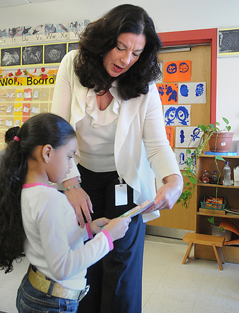 Salem:<br /> Principal Renata McFarland speaks with kindergartener Alexia Beltre at the Bentley Elementary School during her morning rounds at the school.<br /> Photo by Ken Yuszkus/Salem News, Wednesday, January 18, 2012.