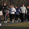 Danvers:<br /> People jog at the Thorpe School field as part of the Couch to 5K! kickoff. More than 100 people sign up to get off couch.<br /> Photo by Ken Yuszkus/Salem News, Monday, March 28, 2011.