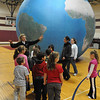 Salem:<br /> Claudette Wile speaks to the 2nd and 3rd grade students in front of the Earth Balloon at Bates School. Students were guided on an interactive journey outside and inside the 20-foot diameter inflatable model of the Earth made up of a high resolution satellite imagees with true to life colors.<br /> Photo by Ken Yuszkus/Salem News,  Friday,  November 5, 2010.