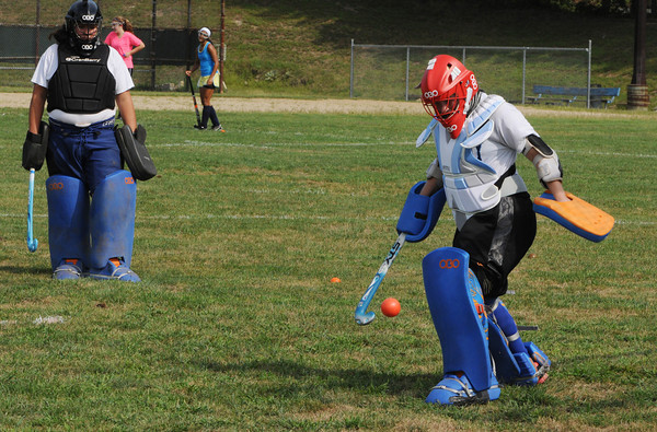 Peabody:<br /> Briana MacDonald, left, watches Holly Smith, one of the three captains, kick an incoming ball to the side during a drill on the first day of field hockey practice at Peabody Veterans Memorial High School<br /> Photo by Ken Yuszkus/The Salem News, Thursday, August 23, 2012.