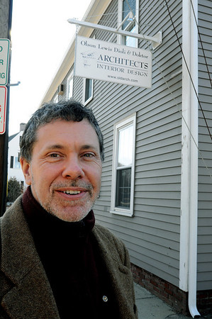 Ipswich:<br /> Chris Doktor stands in front of the office of Olson, Lewis, Dioli and Doktor, Architects, Interior Design. Despite hard times, this local architecture firm is expanding, adding an interior design team and opening a second office in Ipswich.<br /> Photo by Ken Yuszkus/Salem News, Wednesday, January 27, 2010.