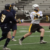 Peabody:<br /> Bishop Fenwick's Will Clancy passes the ball during the Arlington Catholic at Bishop Fenwick boys lacrosse game.<br /> Photo by Ken Yuszkus/Salem News, Wednesday, April 13, 2011.