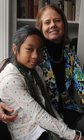 Salem;<br /> Jean Monahan, right, and her adopted daughter Lilah are taking Lilah's first trip to her native country, Cambodia. <br /> Photo by Ken Yuszkus/Salem,  News, Wednesday,  December 15, 2010.