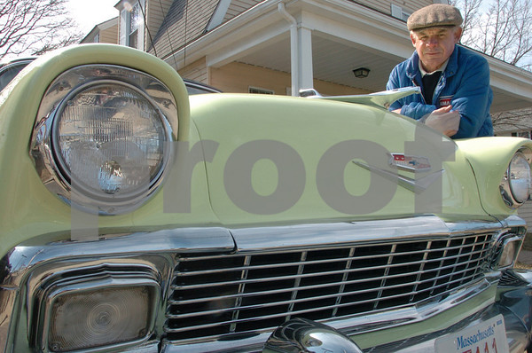 """Peabody:<br /> Billy Dunn is standing next to his classic 56 Chevy BelAir in his driveway. He created a street sign that says, """"Chevy St."""" for his driveway because of his love of Chevys. <br /> Photo by Ken Yuszkus/Salem News, Friday, March 20, 2009."""